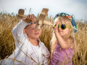 Two children playing in a field